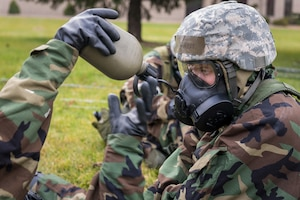 U.S. Air Force Airman 1st Class Kaylee Larkin, a services specialist with the 182nd Force Support Squadron, Illinois Air National Guard, drinks from a canteen while in Mission Oriented Protective Posture 4 during drill weekend training at the 182nd Airlift Wing in Peoria, Ill., Nov. 3, 2018.