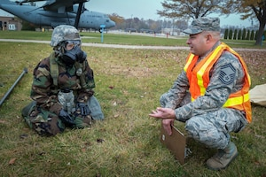 U.S. Air Force Senior Master Sgt. Andrew Edenburn, right, a Wing Inspection Team member with the 182nd Airlift Wing, Illinois Air National Guard, discusses observations with Master Sgt. Mindy Strader, a services craftsman with the 182nd Force Support Squadron, during a full-spectrum readiness exercise in Peoria, Ill., Nov. 3, 2018.