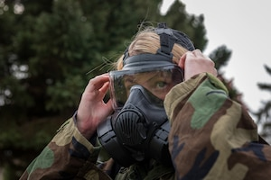 U.S. Air Force Airman 1st Class Gabrielle Tucker, a services specialist with the 182nd Force Support Squadron, Illinois Air National Guard, removes her M50 joint service general purpose mask during a full-spectrum readiness exercise at the 182nd Airlift Wing in Peoria, Ill., Nov. 3, 2018.