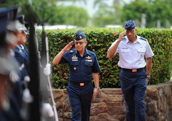 Commander-in-Chief of the Royal Thai air force Chief Air Marshal Chaiyapruk Didyasarin, and U.S. Air Force Commander of Pacific Air Forces (PACAF), Gen. CQ Brown, Jr., salute the honor cordon during a visit to Headquarters PACAF, Joint Base Pearl Harbor-Hickam, Hawaii, Oct. 29, 2018.