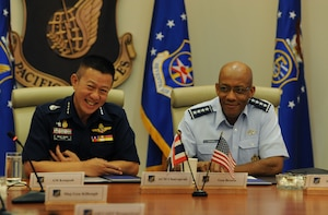 Commander-in-Chief of the Royal Thai air force (RTAF) Chief Air Marshal Chaiyapruk Didyasarin, and U.S. Air Force Commander of Pacific Air Forces (PACAF), Gen. CQ Brown, Jr., listen as USAF and RTAF members introduce themselves before a briefing at Headquarters PACAF, Joint Base Pearl Harbor-Hickam, Hawaii, Oct. 29, 2018.