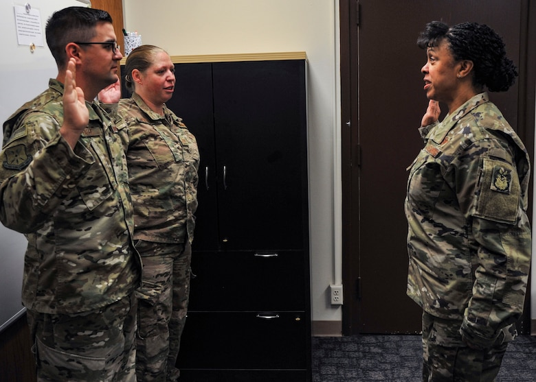 Lt. Gen. Stayce D. Harris (right), Inspector General of the Air Force, swears in new IG inspectors Tech. Sgts. Thomas Faivre and Anastasia Vreeland during a visit to Kirtland Oct. 25. General Harris visited the installation from Oct. 22-26, including this stop at the 377th Air Base Wing IG office. The primary focus of her visit was Kirtland's Air Force Inspection Agency. (U.S. Air Force photo by Jim Fisher)