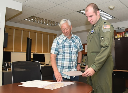 Flight planner goes over mission with pilot.