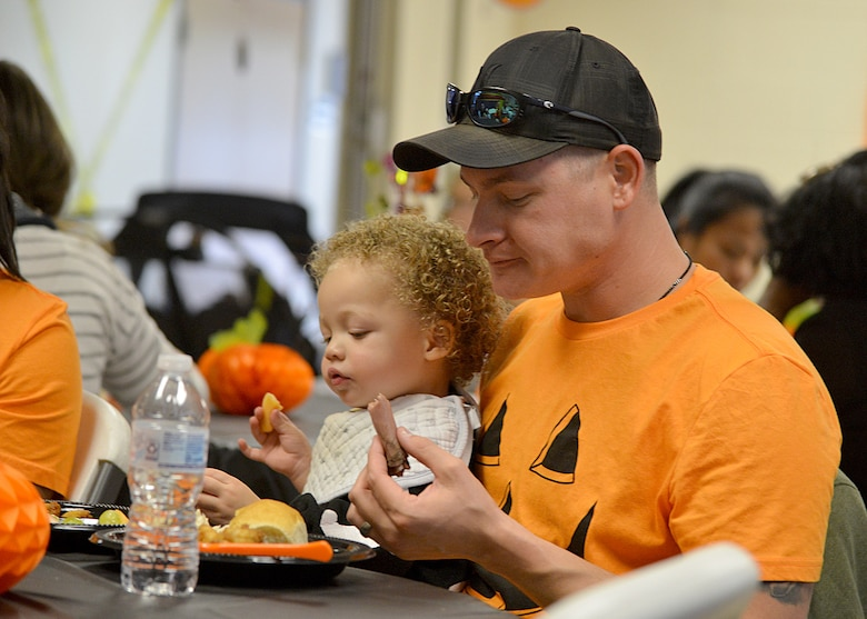 Staff Sgt. Kyle Johnson from 58th Aircraft Maintenance Squadron eats with his son Kaidyn, 2, at a special Halloween Kirtland Playgroup here Oct. 30, 2018. The weekly playgroup is sponsored by Kirtland Family Advocacy and meets every Tuesday from 10:30 a.m. to noon in the Chapel Annex. The group provides unstructured play time for infants, toddlers and their parents. (U.S. Air Force photo by Todd Berenger)