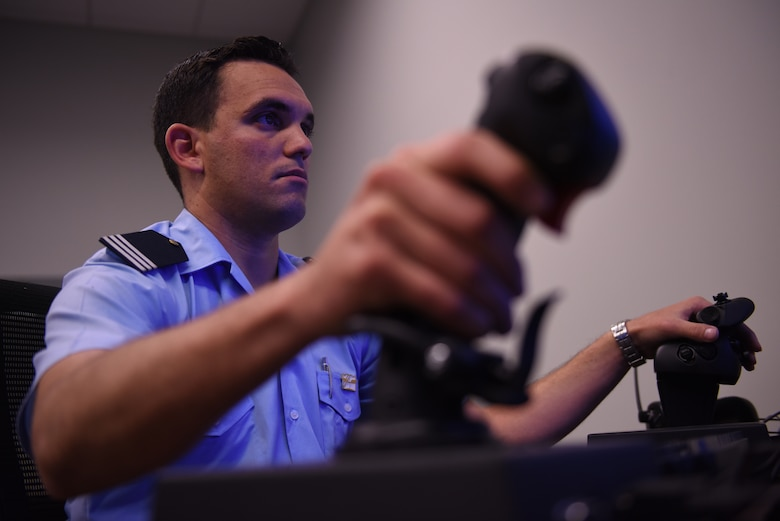 A cadet from a Latin American service academy flies an F-35A Lightning II simulator in the F-35 Academic Training Center Oct. 31, 2018, at Luke Air Force Base, Ariz. Cadets visiting Luke as a part of the Department of Defense Latin American Cadet Initiative program had the opportunity to fly simulators, walk the flightline, and speak to U.S. Air Force officers about their experiences. (U.S. Air Force photo by Senior Airman Ridge Shan)