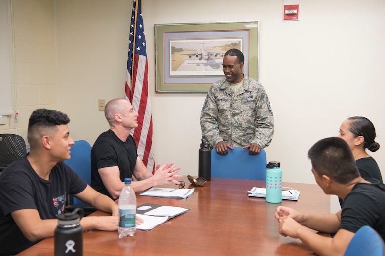 U.S. Air Force Chief Master Sgt. Danyell C. Stoutamire, the Air Force Reserve's 624th Regional Support Group command chief, visits with members of the Development and Training Flight Nov. 3, 2018 at Joint Base Pearl Harbor-Hickam, Hawaii. The D&TF is a program designed to prepare new enlistees, ensuring they are physically and mentally prepared for basic military training. (U.S. Air Force photo by Master Sgt. Theanne Herrmann)