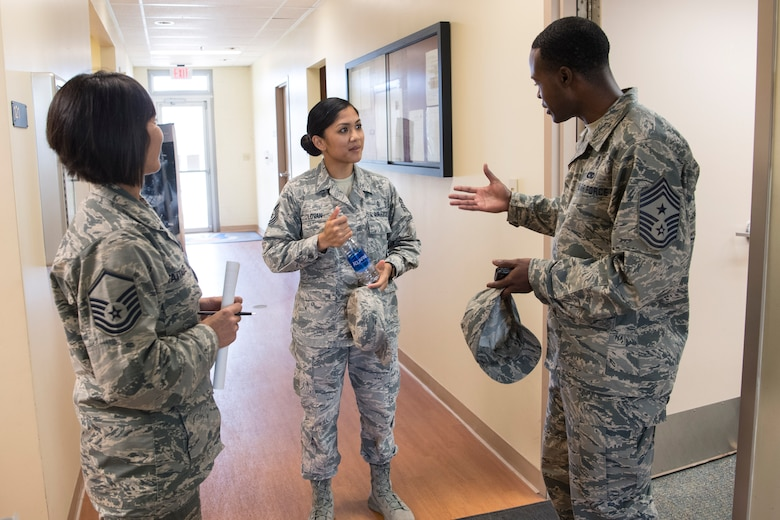 U.S. Air Force Chief Master Sgt. Danyell C. Stoutamire, the new command chief for the Air Force Reserve's 624th Regional Support Group, visits with Tech. Sgt. Reiko Lovan and Master Sgt. Josephine Taitague during his first unit training assembly with the Group Nov. 3, 2018 at Joint Base Pearl Harbor-Hickam, Hawaii. Located on Oahu and Guam, the 624th RSG provides nearly 700 combat-ready Airmen who specialize in aerial port, aeromedical support and civil engineering operations. (U.S. Air Force photo by Master Sgt. Theanne Herrmann)