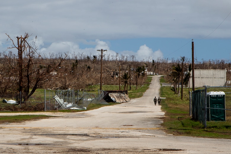Marines with Combat Logistics Battalion 31 walk along a cleared road during the U.S. Defense Support of Civil Authorities relief effort in response to Super Typhoon Yutu, Tinian, Commonwealth of the Northern Mariana Islands, Nov. 3, 2018. Businesses, government buildings, homes and schools were heavily damaged by Super Typhoon Yutu, which made a direct hit with devastating effect on Tinian Oct. 25 packing 170 MPH winds – it is the second strongest storm to ever hit U.S. soil and the strongest storm of 2018. Marines with the 31st Marine Expeditionary Unit and CLB-31 have been leading a multi-service contingent since Oct. 29 as part of the U.S. Federal Emergency Management Agency-directed DSCA mission here. The Marines arrived at the request of CNMI officials and FEMA to assist relief efforts in the wake of Yutu, the largest typhoon to ever hit a U.S. territory. The 31st MEU, the Marine Corps' only continuously forward-deployed MEU, provides a flexible force ready to perform a wide-range of military operations across the Indo-Pacific region.