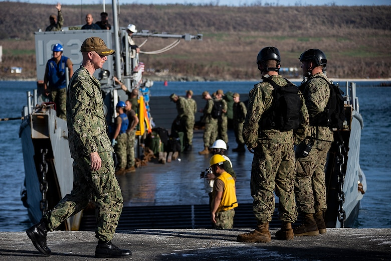 Sailors with the dock landing ship USS Ashland sit pier-side aboard a landing craft at the port during the U.S. Defense Support of Civil Authorities relief effort in response to Super Typhoon Yutu, Tinian, Commonwealth of the Northern Mariana Islands, Nov. 3, 2018. Businesses, government buildings, homes and schools were heavily damaged by Super Typhoon Yutu, which made a direct hit with devastating effect on Tinian Oct. 25 packing 170 MPH winds – it is the second strongest storm to ever hit U.S. soil and the strongest storm of 2018. Marines with the 31st Marine Expeditionary Unit and CLB-31 have been leading a multi-service contingent since Oct. 29 as part of the U.S. Federal Emergency Management Agency-directed DSCA mission here. The Ashland arrived today to deliver a larger contingent of Marines and Seabees to further assist the people of Tinian. The Marines arrived at the request of CNMI officials and FEMA to assist relief efforts in the wake of Yutu, the largest typhoon to ever hit a U.S. territory. The 31st MEU, the Marine Corps' only continuously forward-deployed MEU, provides a flexible force ready to perform a wide-range of military operations across the Indo-Pacific region.
