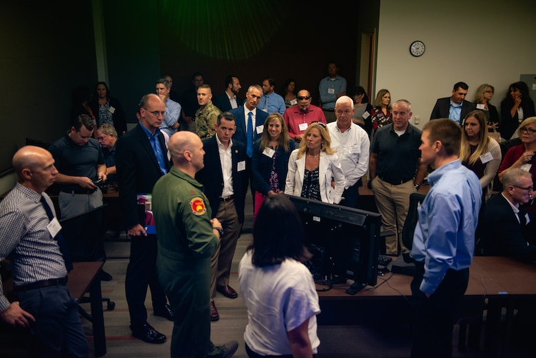 Maj. William Andreotta, 56th Training Squadron director of operations, speaks to Personalized Learning Cohort members during their tour at Luke Air Force Base, Ariz., Nov. 2, 2018. The Personalized Learning Cohort consists of educational leaders from around the United States who work to overcome organizational barriers and create a sustainable network supporting ownership of learning. (U.S. Air Force photo by Senior Airman Alexander Cook)