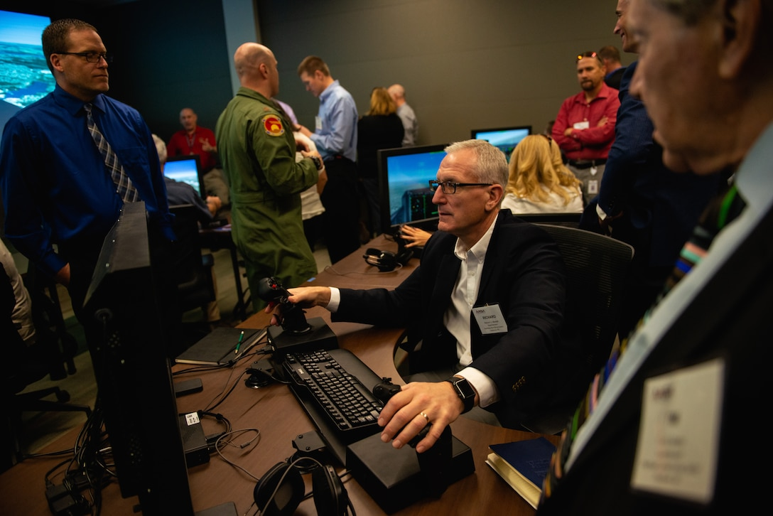 A Personalized Learning Cohort member flies a pilot training simulator during a visit to Luke Air Force Base, Ariz., Nov. 2, 2018. Throughout the tour, members of the cohort were given the opportunity to speak with Airmen and receive a comprehensive review of some of the resources and tools used to train fighter pilots. (U.S. Air Force photo by Senior Airman Alexander Cook)