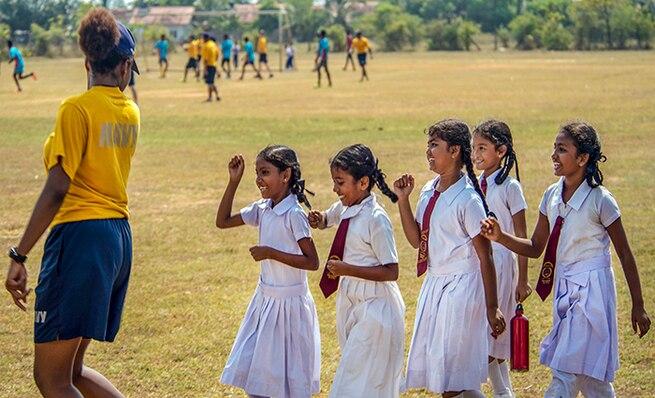 U.S. Navy member with Sri Lankan children