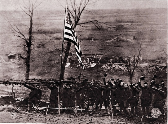 After this gun section of Battery D, 105th Field Artillery Regiment, New York National Guard, had fired its last shot at Etraye, the men raised Old Glory amid triumphant shouts on Armistice Day, Nov. 11, 1918.
