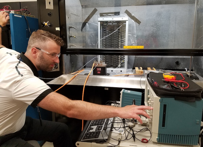 Air Force Research Laboratory electrical engineer Corey Boltz makes final adjustments before conducting a proof-of-concept arc test in preparation for follow-up testing to support a NASA research effort. (U.S. Air Force Photo/Holly Jordan)