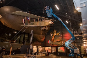DAYTON, Ohio -- National Museum of the U.S. Air Force restoration crews lowered the Curtiss JN-4D Jenny from its hanging position on Nov. 7 2018 in the Early Years Gallery. Plans call for the Avro 504K to hang above the JN-4D after the restoration process is completed. (U.S. Air Force photo by Ken LaRock)
