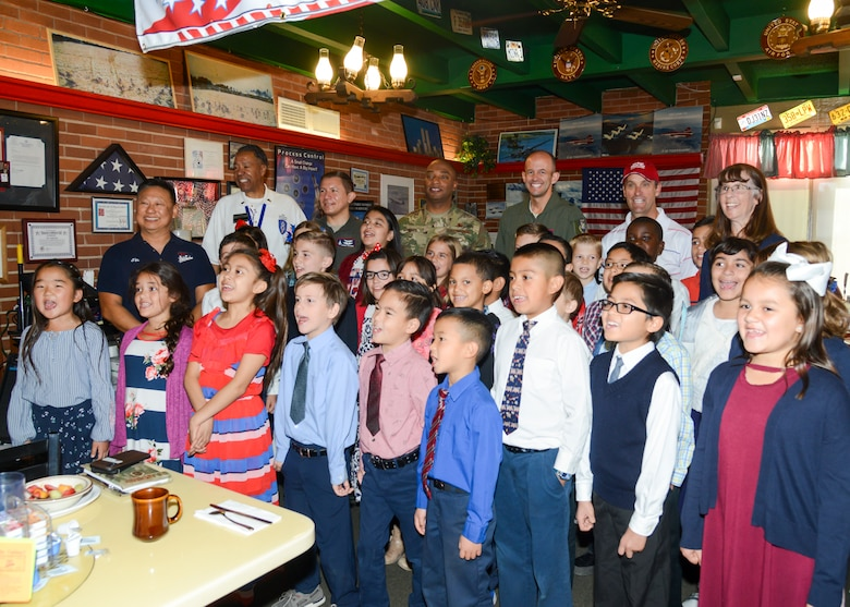Brig. Gen. E. John Teichert and Command Chief Master Sgt. Roosevelt Jones, 412th Test Wing commander and command chief master sergeant, pose for a photo with children from Lancaster Baptist School and U.S. Rep. Steve Knight photo during a Coffee4Vets gathering at Crazy Otto's Diner in Lancaster, California, Nov. 6. Coffee4Vets meet every Tuesday at the restaurant for fellowship and camaraderie. (U.S. Air Force photo by Giancarlo Casem)