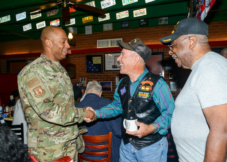Command Chief Master Sgt. Roosevelt Jones, 412th Test Wing command chief master sergeant, greets local Veterans at a Coffee4Vets gathering at Crazy Otto's Diner in Lancaster, California, Nov. 6. Coffee4Vets meet every Tuesday at the restaurant for fellowship and camaraderie. (U.S. Air Force photo by Giancarlo Casem)