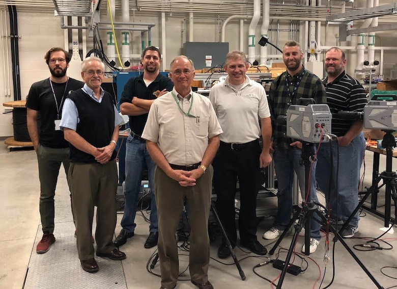 AFRL and NASA researchers teamed to conduct low-pressure arc fault testing in support of a NASA effort to determine the effects of arcing in Earth-orbit conditions. Pictured from left to right:  Erick Rossi De La Fuente, Dan Schweickart, Christopher Kostyk, Dennis Grosjean, Brett Jordan, Corey Boltz, and Dan O'Brien. (U.S. Air Force Photo/Richard Ryman)