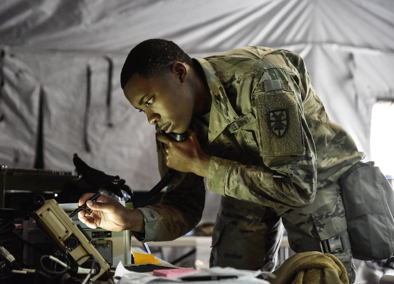 U.S. Army Spc. Ali Armstrong, 331st Transportation Company, 11th Trans. Battalion, 7th Trans. Brigade (Expeditionary) communication specialist, sends a situational report to the battalion Tactical Operation Center at Fort Pickett, Virginia, Oct. 23, 2018.