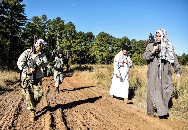 U.S. Army Soldiers assigned to the 1098th Transportation Detachment, 11th Trans. Battalion, 7th Trans. Brigade (Expeditionary), dress in opposition force clothing and prepare to simulate an attack on a neighboring unit at Fort Pickett, Virginia. Oct. 29, 2018.
