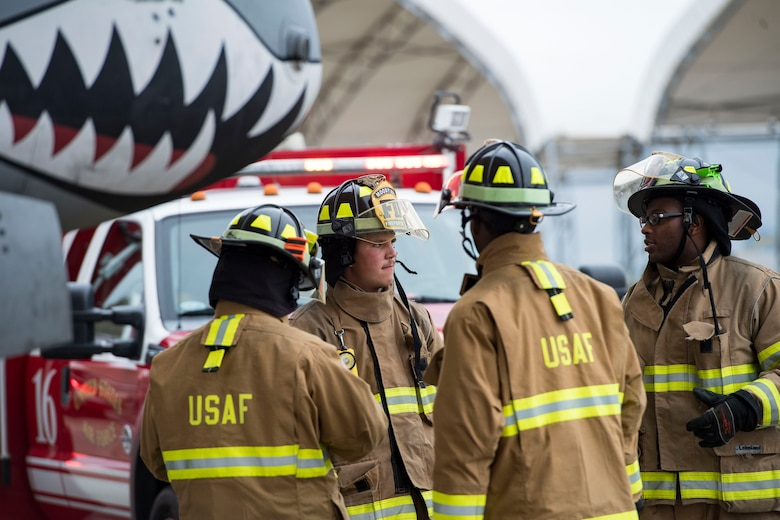 Firefighters from the 23d Civil Engineer Squadron discuss tactics, techniques and procedures during an A-10C Thunderbolt II egress exercise, Nov. 5, 2018, at Moody Air Force Base, Ga. The five-day exercise, scheduled to take place Nov. 5-9, will give base personnel an opportunity to experience contingency operations in a contested and degraded combat environment. (U.S. Air Force photo by Senior Airman Janiqua P. Robinson)