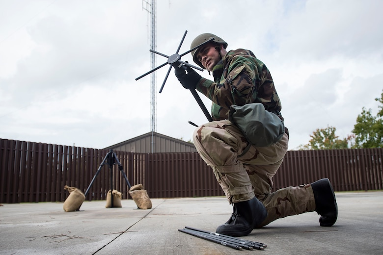 Airman 1st Class Bryson Hart, 23d Communications Squadron radio frequency transmissions technician, assembles a UVU-200 Antenna during an antenna assembly exercise, Nov. 6, 2018, at Moody Air Force Base, Ga. The five-day exercise, scheduled to take place Nov. 5-9, will give base personnel an opportunity to experience contingency operations in a contested and degraded combat environment. (U.S. Air Force photo by Senior Airman Janiqua P. Robinson)