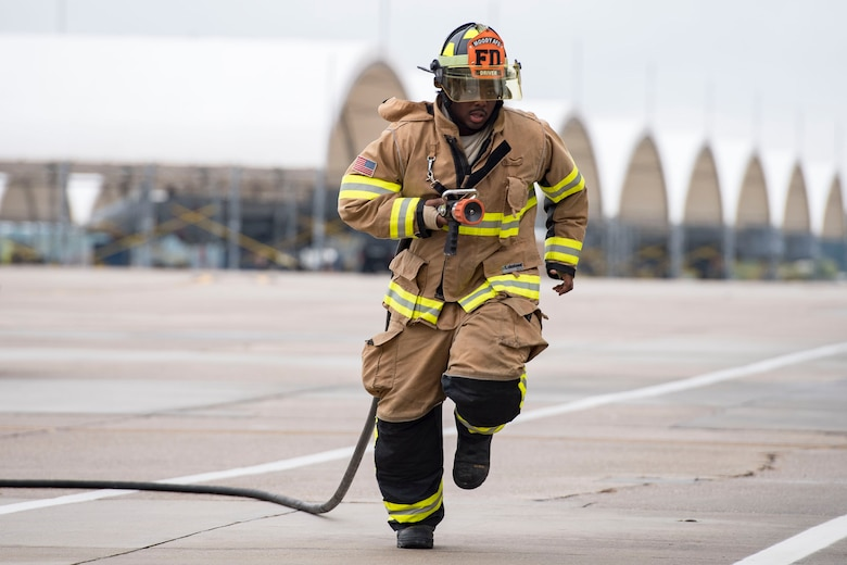 Senior Airman Jeffrey Young, 23d Civil Engineer Squadron firefighter, sprints to a simulated aircraft fire during an A-10C Thunderbolt II egress exercise, Nov. 5, 2018, at Moody Air Force Base, Ga. The five-day exercise, scheduled to take place Nov. 5-9, will give base personnel an opportunity to experience contingency operations in a contested and degraded combat environment. (U.S. Air Force photo by Senior Airman Janiqua P. Robinson)