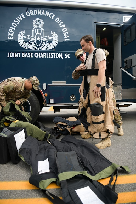 1st Lt. Paul Underwood, 628th Explosive Ordinance Disposal flight chief, dons a bomb suit before the start of the 2018 Charleston Veterans Day Parade Nov. 4, 2018, in Charleston, S.C. This year's Veterans Day, officially recognized Nov. 11, 2018, will mark the 100th anniversary of the end of the First World War.