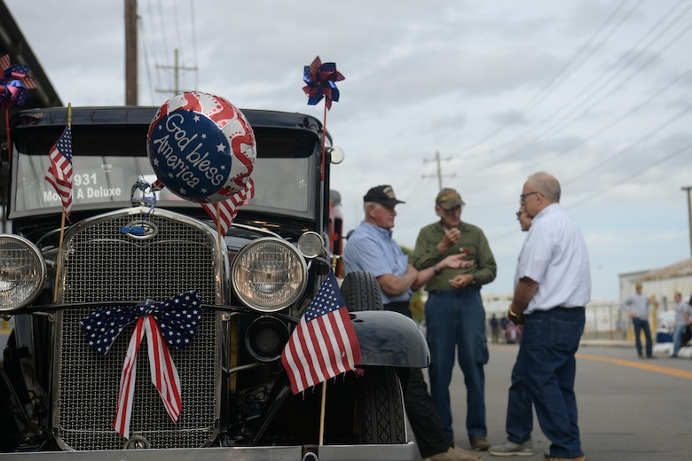 A group of men stand next to a 1931 Ford Model A as they wait to line up in the Veterans Day Parade Nov. 4, 2018, in Charleston, S.C. The car was decorated for the city's annual Veteran's Day Parade. This year's Veterans Day, officially recognized Nov. 11, 2018, will mark the 100th anniversary of the end of the First World War.
