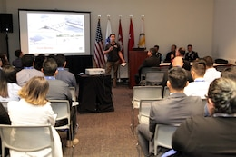 """Chad Allen, a resident engineer with Los Angeles District, talks to college students and recent graduates attending the USACE seminar at the Hispanic Engineer Achievement Awards Corporation conference Oct. 19 in Pasadena, California. With the theme, """"Travel the world ... make an impact ... build big things,"""" panel members presented information on the Corps, its missions and the opportunities a Corps career provides employees."""