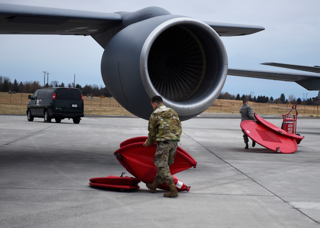 Staff Sgt. Austin Garcia and Senior Airman Dan O'Connor, 92nd Aircraft Maintenance Squadron crew chiefs, remove engine covers as part of an alert response during Exercise Global Thunder 2019 at Fairchild Staff Sgt. Austin Garcia and Senior Airman Dan O'Connor, 92nd Aircraft Maintenance Squadron crew chiefs, remove engine covers as part of an alert response during Exercise Global Thunder 2019 at Fairchild Air Force Base, Washington, November 2018. Global Thunder is a U.S. Strategic Command exercise designed to ensure an efficient mission response by testing Airmen's ability to execute command, control and operational procedures during simulated combat scenarios. (U.S. Air Force photo/Airman 1st Class Lawrence Sena)