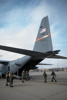 Airmen with the 182nd Airlift Wing, Illinois National Guard, board a C-130H Hercules during a full-spectrum readiness exercise at the 182nd Airlift Wing in Peoria, Ill., Nov. 3, 2018.