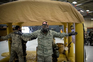 U.S. Air Force Col. Daniel McDonough, the commander of the 182nd Airlift Wing, Illinois Air National Guard, completes the final steps of a Contamination Control Area during a full-spectrum readiness exercise at the 182nd Airlift Wing in Peoria, Ill., Nov. 3, 2018.
