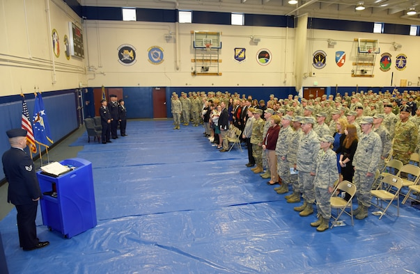 Members of the 310th Space Wing watch as Col. Traci L. Kueker-Murphy relinquishes command to Col. Dean D. Sniegowski during a change of command ceremony, Nov. 3rd, 2018