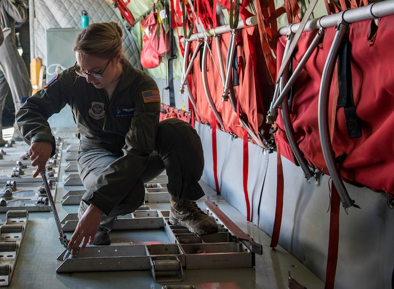 Senior Airman Megan Hatch, 93rd Air Refueling Squadron boom operator, secures the floor pattern for cargo to be loaded onto a KC-135 Stratotanker for transport at Fairchild Air Force Base, Washington, Oct. 17, 2018. Floor patterns are specifically placed pallets to protect the floor of the aircraft while the aircrew reviews and executes the procedures to successfully load and off load cargo safely.  (U.S. Air Force photo/Airman 1st Class Whitney Laine)