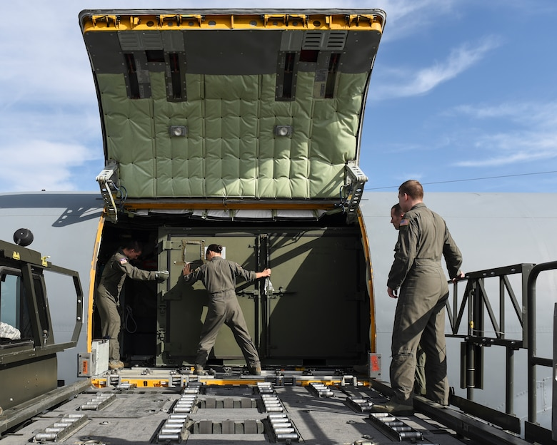 A Team Fairchild aircrew offloads a container from a KC-135 Stratotanker during cargo load training at Fairchild Air Force Base, Washington, Oct. 17, 2018. Cargo training is designed to keep Airmen skillful in executing proper processing and loading procedures. (U.S. Air Force photo/Airman 1st Class Whitney Laine)