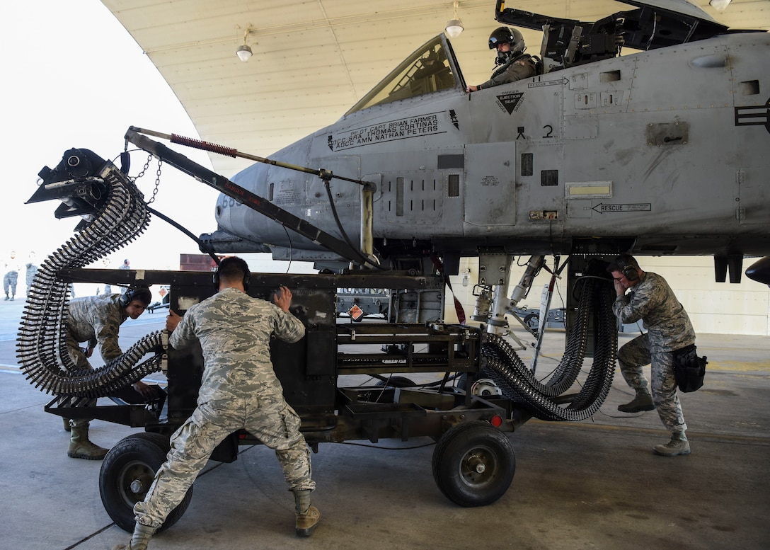 A 51st Maintenance Group standardized load crew team prepare to load munitions onto an aircraft at Osan Air Base, Republic of Korea, Nov. 2, 2018. The crew loaded munitions onto the aircraft while the engines were running in an attempt to create a quick turnaround time for the aircraft to return to its flight. (U.S. Air Force photo by Airman 1st Class Ilyana A. Escalona)