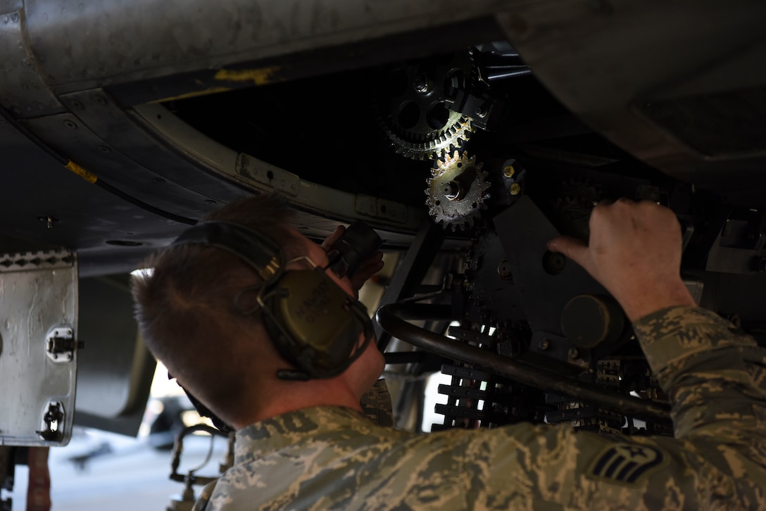 U.S. Air Force Staff Sgt. Nathaniel Awrey, 51st Maintenance Group standardized load crew team lead, ensures that a munitions loader is secured to begin loading at Osan Air Base, Republic of Korea, Nov. 2, 2018. Awrey led his team in the completion of a weapons load during a new loading operation. (U.S. Air Force photo by Airman 1st Class Ilyana A. Escalona)