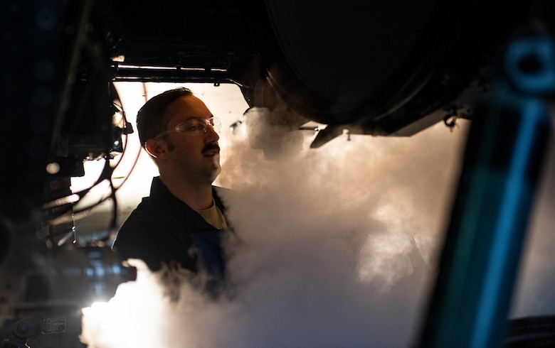 U.S. Air Force Tech. Sgt. Tyler Stratman, 309th Aircraft Maintenance Group depot structural maintenance specialist from Hill Air Force Base, Utah, sprays the bulkhead of an F-16 Fighting Falcon with liquid nitrogen at Kunsan Air Base, Republic of Korea, Nov. 8, 2018. Due to normal wear and tear after years of flying and performing combat and training operations, the bulkhead had to be replaced in order to maintain the F-16 Fighting Falcon's lethality. (U.S. Air Force photo by Senior Airman Stefan Alvarez)