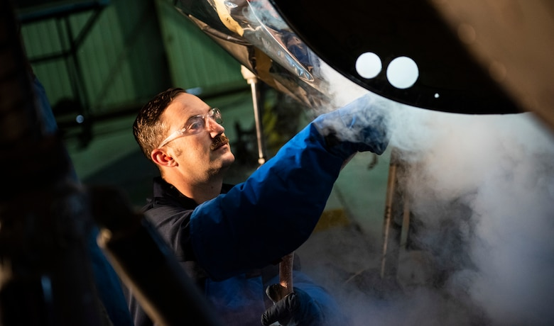 U.S. Air Force Tech. Sgt. Tyler Stratman, 309th Aircraft Maintenance Group depot structural maintenance specialist from Hill Air Force Base, Utah, sprays the bulkhead of an F-16 Fighting Falcon with liquid nitrogen at Kunsan Air Base, Republic of Korea, Nov. 8, 2018. Multiple components on aircraft have to be replaced in order to maintain the lifespan, keep them operational, and sharpen the lethality of the Wolf Pack fleet. (U.S. Air Force photo by Senior Airman Stefan Alvarez)