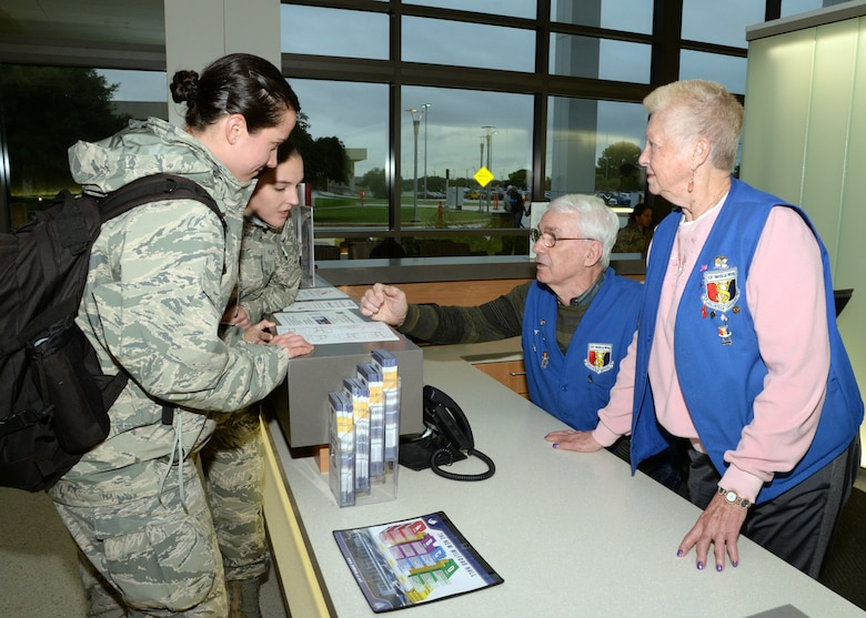 Fred Baker and Viola Calaman, 59th Medical Wing volunteers, assist two Airmen at the A desk in Wilford Hall Ambulatory Surgical Center on Joint Base San Antonio-Lackland, Texas. Volunteers throughout 59th MDW range in age from 18 to 94 and gave more than $1 million in free labor in 2017. 