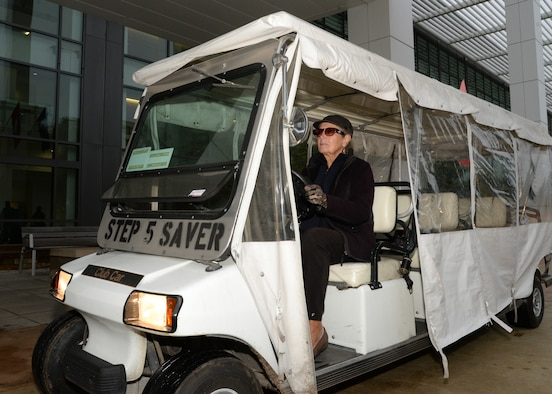 Darlene Neubert, Step Saver carts driver of Wilford Hall Ambulatory Surgical Center on Joint Base San Antonio-Lackland, Texas, prepares to go out to WHASC's parking areas to pick up patients. Volunteers like Neubert, work in clinics and facilities throughout 59th MDW and give more than $1 million in free labor annually. 