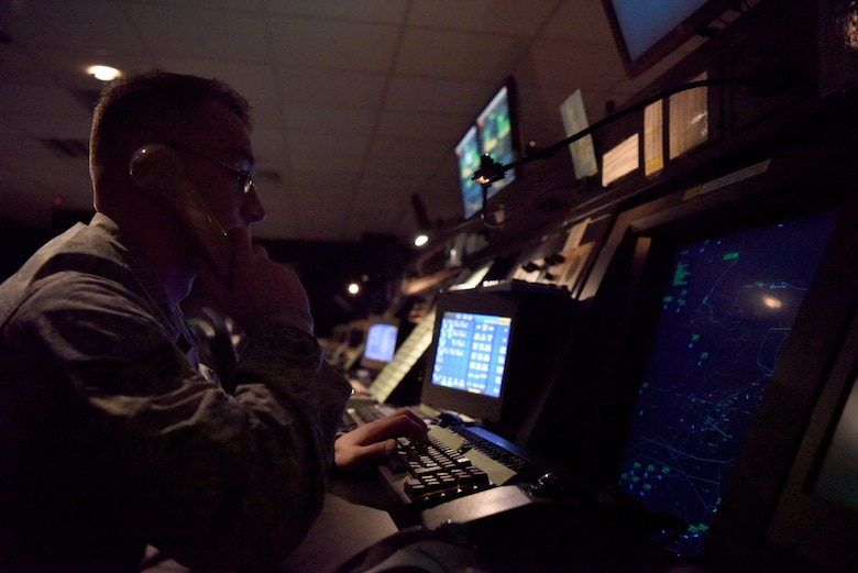 An Airman from the 48th Operations Support Squadron Radar Approach Control monitors air traffic around Royal Air Force Lakenheath, England, Oct. 03, 2018. Airmen from the Radar, Airfield and Weather Systems flight ensure that every sensor and piece of monitoring equipment is calibrated and accurate to provide RAPCON with a precise picture of the surrounding airspace.  (U.S. Air Force photo by Senior Airman John A. Crawford)