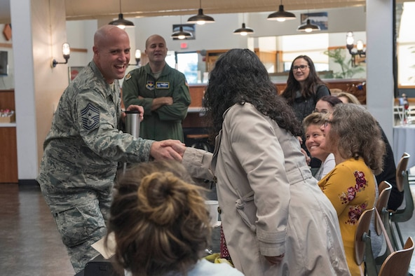 Chief Master Sgt. Randy Kay II, 97th Air Mobility Wing command chief, welcomes new military spouses during the Heartlink Spouse Orientation program.