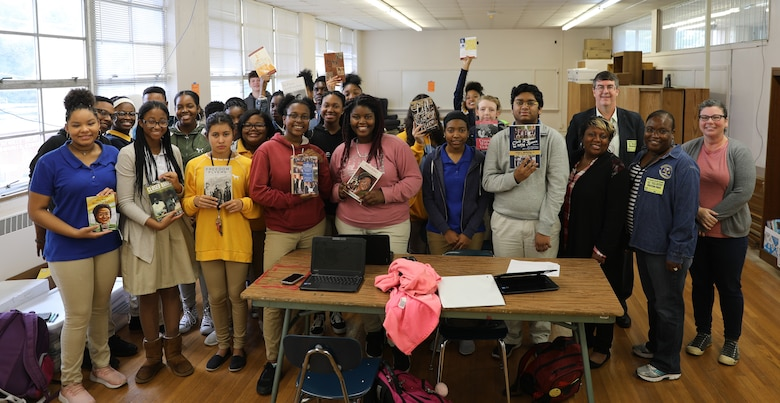 Students at Booker T. Washington Magnet High School receive some of the books donated by the Muir S. Fairchild Research Information Center. On right, Air University library staff Ataya Wallace, Mehmed Ali, Monica Tolver with media specialist Jennifer Sanford. (Courtesy Photo)