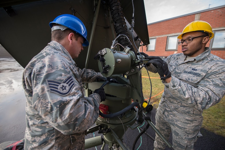 U.S. Air Force Staff Sgt. Charles Alexander, 269th Combat Communications Squadron radio frequency transmissions systems technician, left, and Airman 1st Class Donte Patrick, 1st CBCS radio frequency transmissions systems technician, inspect a satellite antenna for corrosion during Exercise Trident Juncture 18 at Rovaniemi, Finland, Nov. 1, 2018. The exercise increases security by deterring possible threats and enhancing interoperability among NATO allies and partners. (U.S. Air Force photo by Senior Airman Luke Milano)