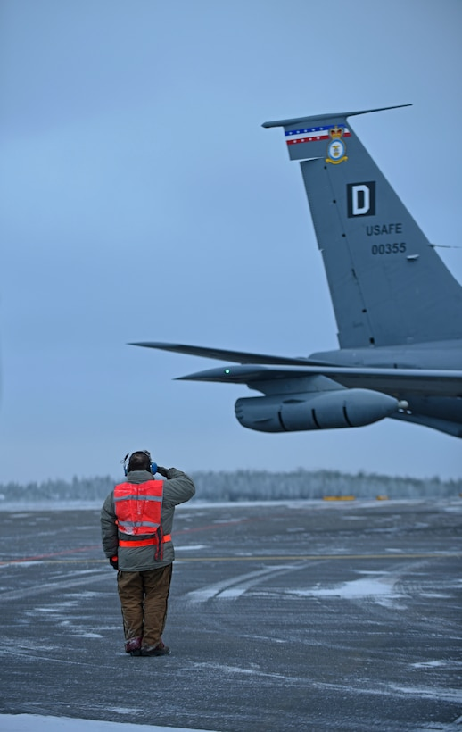 U.S. Air Force Senior Airman Nicholas Vidmar, 100th Aircraft Maintenance Squadron crew chief, salutes after marshalling a U.S. Air Force KC-135 Stratotanker before takeoff to conduct aerial refueling training during Exercise Trident Juncture 18, at Rovaniemi, Finland, Oct. 27, 2018. Trident Juncture is the largest NATO exercise since 2002, with more than 50,000 military members from 31 nations. The U.S. military makes up approximately a quarter of the participating personnel. (U.S. Air Force photo by Senior Airman Luke Milano)