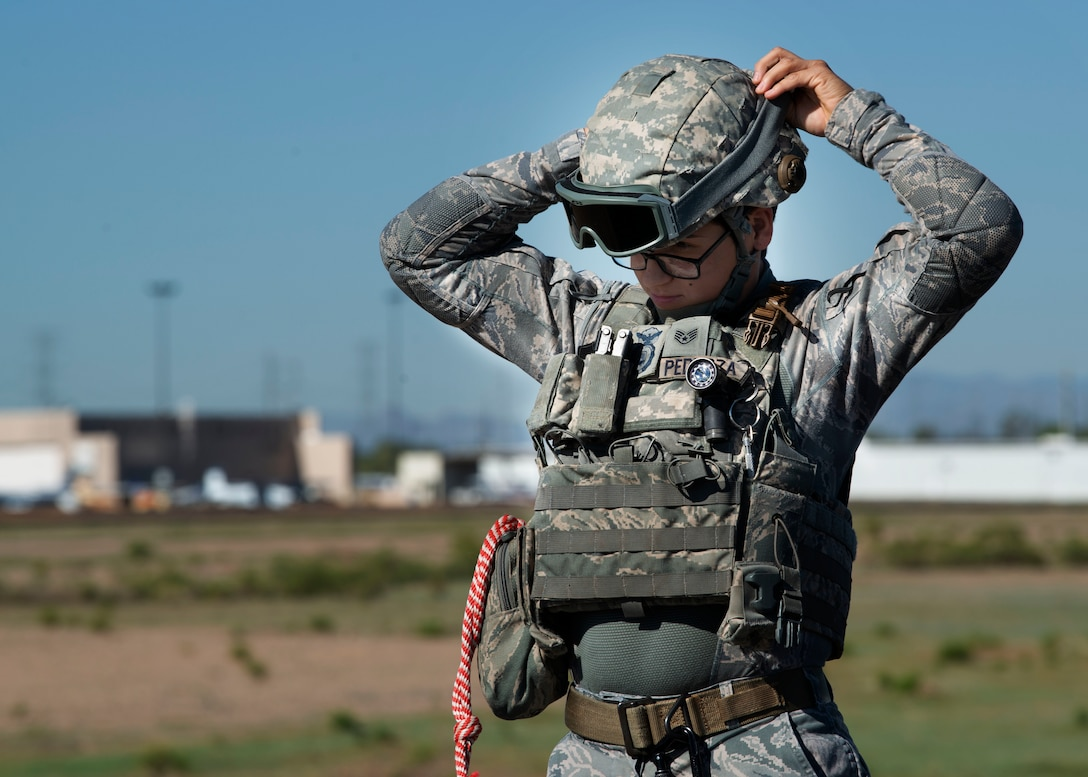 Staff Sgt. Elizabeth Pedroza, 56th Security Forces Squadron military working dog handler, adjusts her personal protective equipment before a joint training exercise at Glendale Municipal Airport Nov. 2, 2018, in Glendale, Ariz.