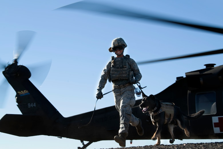 Senior Airman Amber Gordon, 56th Security Forces Squadron military working dog handler, exits a UH-60 Black Hawk after a joint training exercise at Glendale Municipal Airport Nov. 2, 2018, in Glendale, Ariz.