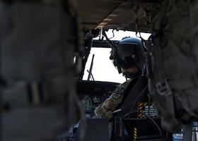 A UH-60 Black Hawk crew member from the Arizona Army National Guard checks on the service members aboard during a joint training exercise at Glendale Municipal Airport Nov. 2, 2018, in Glendale, Ariz.